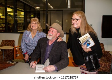 Author Craig Johnson with fans at the Friends of Fallbrook Library 19th Annual Community Read and Autograph Signing on Feb. 16, 2019 at Fallbrook Public Library, Fallbrook, CA.