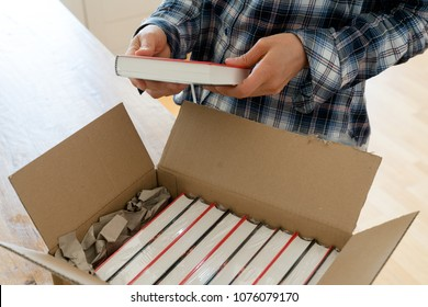 author opens package with samples of her new book and checks the hardcover