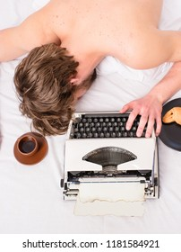 Author tousled hair fall asleep while write chapter top view. Man with typewriter coffee lay bed. Man sleepy lay bedclothes while work. Writer used old fashioned typewriter. Workaholic fall asleep.
