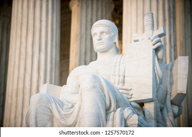 Authority of Law statue holding a tablet with the inscription Lex (Latin for Law) at the entrance to the US Supreme Court building in Washington DC