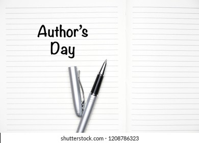 "An ""Author's Day"" wording with a note book and a pen over red background"