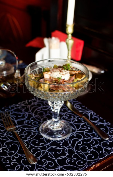 Author's salad with egg poached in a beautiful vintage dish on a table in a restaurant