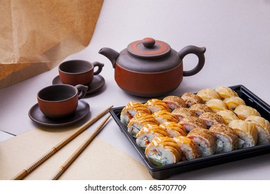 Author's sushi. A hearty meal. Bright taste. Japanese food. Fresh fish. Original serving of the dish. Unforgettable dinner.