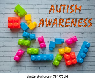 Autism awareness concept with colorful building blocks on white background.