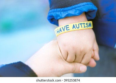 Autism Awareness Picture-I have Autism -Autism Mom holding hand her Autistic Child