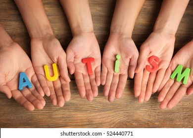 Autism word on people hands