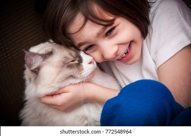 Autistic girl with her Siberian cat - Pet therapy