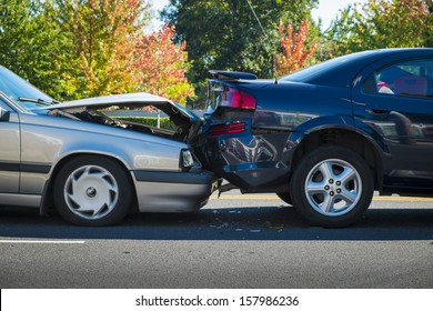 Auto accident involving two cars on a city street