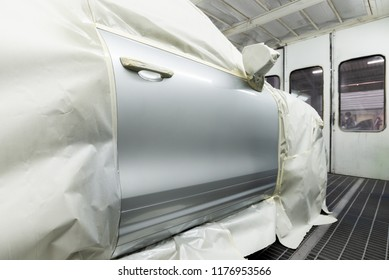 Auto body repair series: Closeup of grey SUV door in paint booth