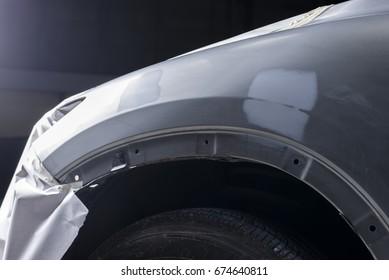 Auto body repair series: Closeup of gray car waiting for repaint