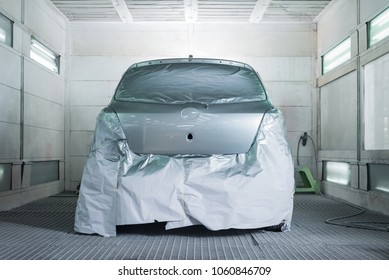 Auto body repair series: Gray car in paint booth after repaint