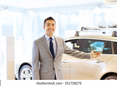auto business, car sale, consumerism and people concept - happy man at auto show or salon