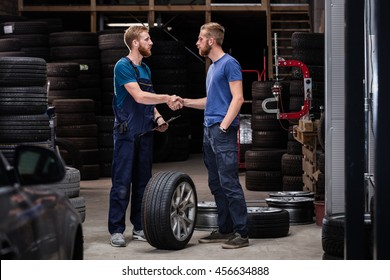 Auto business, car sale, deal, gesture and people concept: men shaking hands in car service.