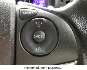 Auto cruise control panel on modern car steering