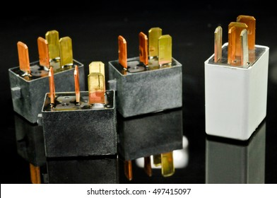 Auto electronic collection on black background. Car electromagnetic relay switch. Car automotive sensor
