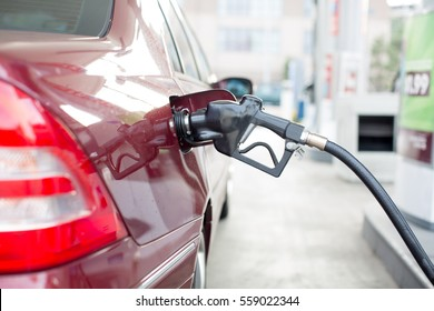 An auto filling up gasoline at a gas station.