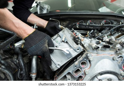 The auto mechanic deconstructs the internal combustion engine