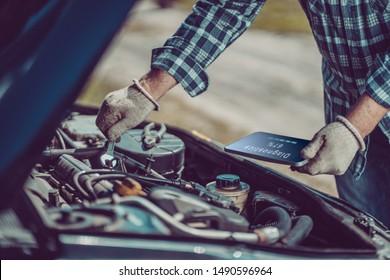Auto mechanic diagnoses a car during car repair services. Machine diagnostics