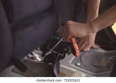Auto mechanic fixing car in repair shop