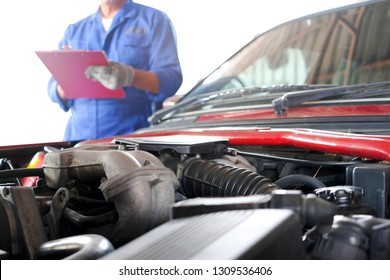 auto mechanic He notes the defective item of the engine at the maintenance center. soft focus