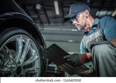 Auto Mechanic Job. Caucasian Car Service Technician with Vehicle Repairs History Report.