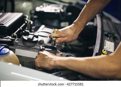 Auto mechanic repair engine in a car repair shop. Close up