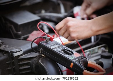 Auto mechanic repairing car in body shop
