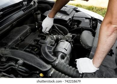auto mechanic repairing the car. hands closeup
