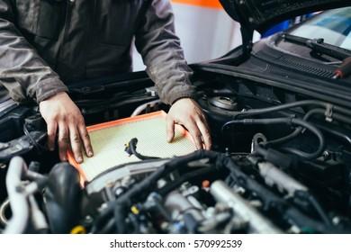 Auto mechanic repairing car. Selective focus.