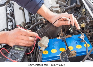 auto mechanic use digital multimeter check voltage battery and check fuse.