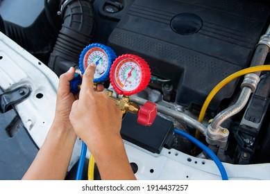 Auto mechanic uses a The pressure gauge on the air compressor,liquid air pressure,compressor,manometer