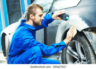 auto mechanic worker applying washing car body preparing for painting at automobile repair and renew service station