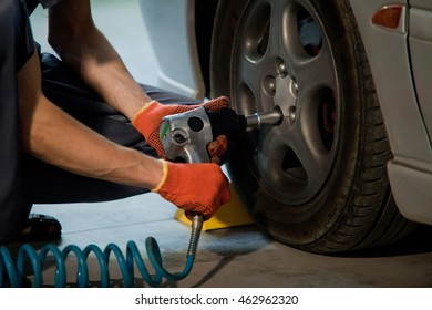 Auto mechanic worker in garage. Auto service and diagnostic