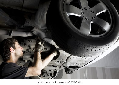 Auto mechanic working at auto repair shop