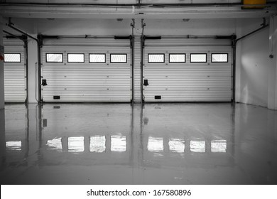 an auto motor speedway garage, interior, windows