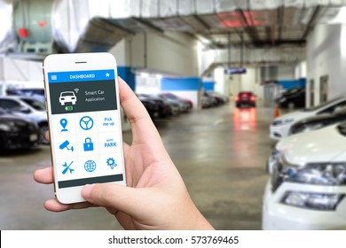 Auto park , pick me up , auto drive and internet of things in smart car concept. Hand holding smart phone and application dashboard with blur car parking background