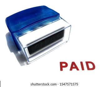 AUTO Pay Office Self Inking Rubber Stamp tool with red word paid isolated on the white background.