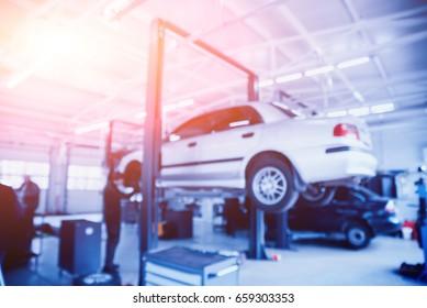 Auto repair service. Blurred background.