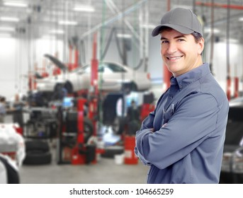Auto repair service. Handsome smiling mechanic.