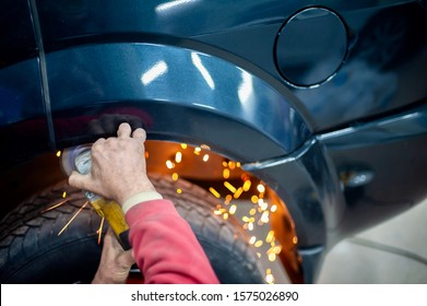 auto repair shop.  work with the grinder.  metal processing.  sparks.