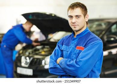 auto repairman mechanic portrait in car auto repair or maintenance shop service station