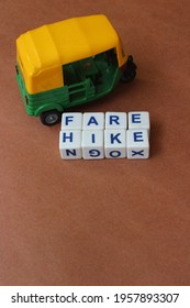 Auto rickshaw fare hike depiction on brown background