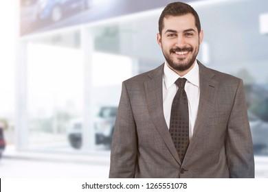 auto salesman in showroom