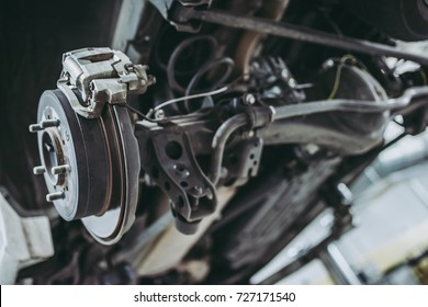Auto service. Car repair and maintenance. Suspension with brake shoe and brake disk.