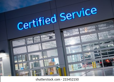 Auto Service. Certified Car Service Gates at Night.