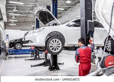 Auto service. The master performs maintenance, oil change, computer diagnostics, replacement of auto parts, repair of the brake system. Modern universal car service. Shymkent Kazakhstan April 15, 2019
