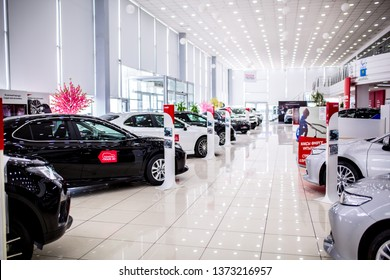 Auto showroom. Toyota brand cars are in a row, polished beautiful modern cars with a shiny surface reflecting beautiful light illumination in the hall. Copy space. Shymkent Kazakhstan April 15, 2019