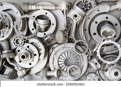 Auto spare parts car. Background. Walpaper. Decorative installation in the form of silver painted automotive parts. Old deatails.