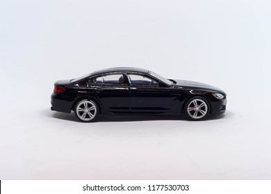 Auto toy limousine in black on a white background