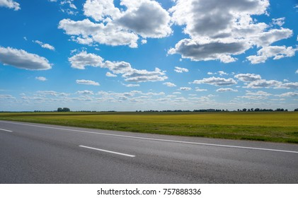 Autobahn in the background of a blue sky with clouds